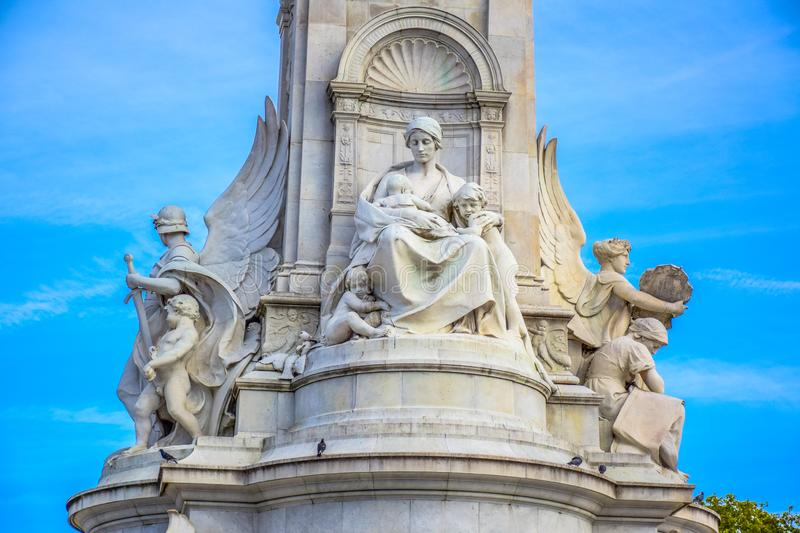 Sculpture of Queen Victoria at Victoria Memorial in front of Buckingham Palace, London, United Kingdom stock photos