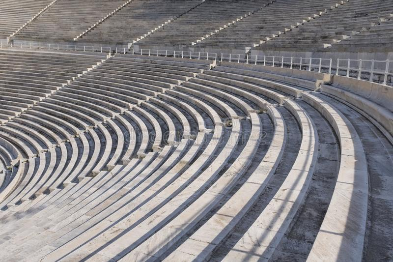 Marble seats and sections in the ancient Panathenaic stadium in Athens, Greece. Sections of marble seats in the ancient Panathenaic stadium in Athens, Greece stock photo
