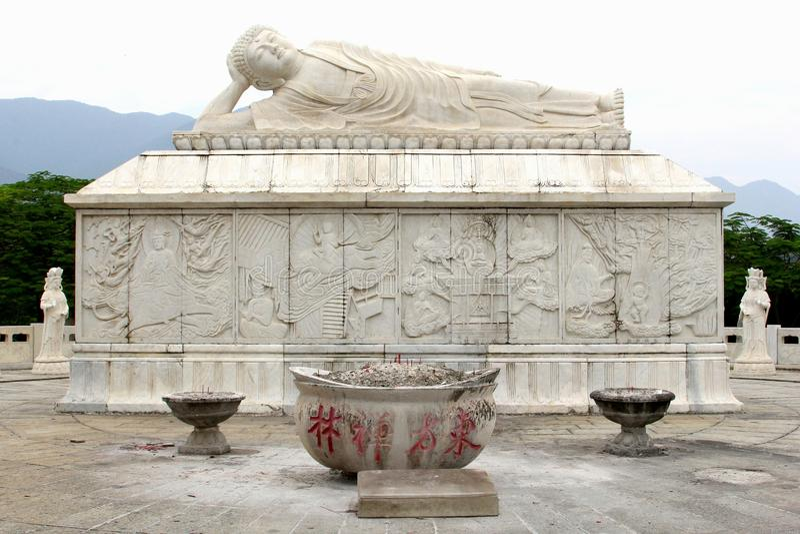 Marble shrine and a white reclining Zen Buddha, China stock images