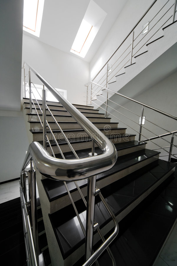 Marble staircase. With a steel handrail in a modern building stock images