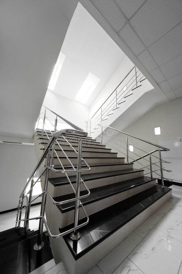 Marble staircase with a steel handrail stock photo