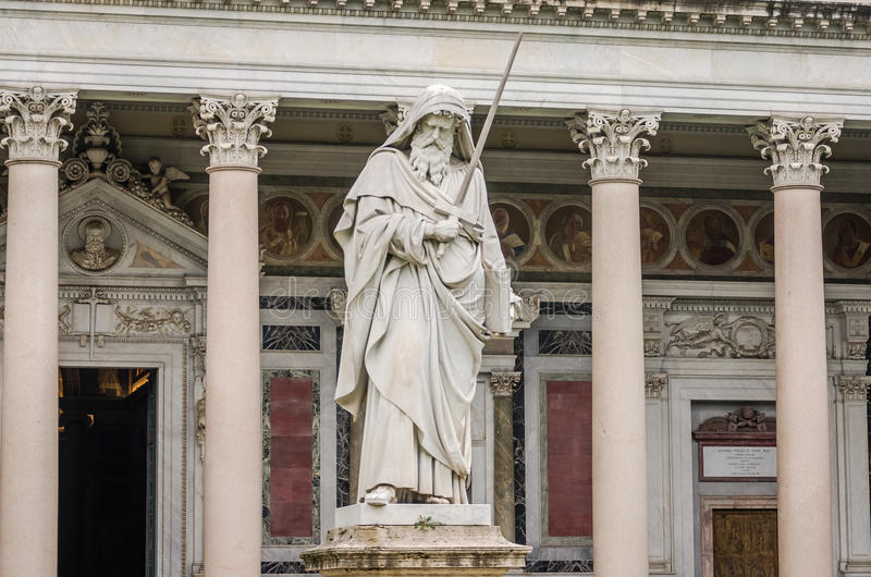 Marble statue of the apostle in the church yard of the Cathedral Basilica of St. Paul Fuori le Mura in Rome, Italy. Marble statue of the apostle in the church royalty free stock image