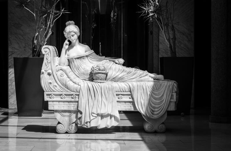 Marble statue in Hotel lobby. A marble statue of a woman in a hotel lobby in Gran Canaria royalty free stock images