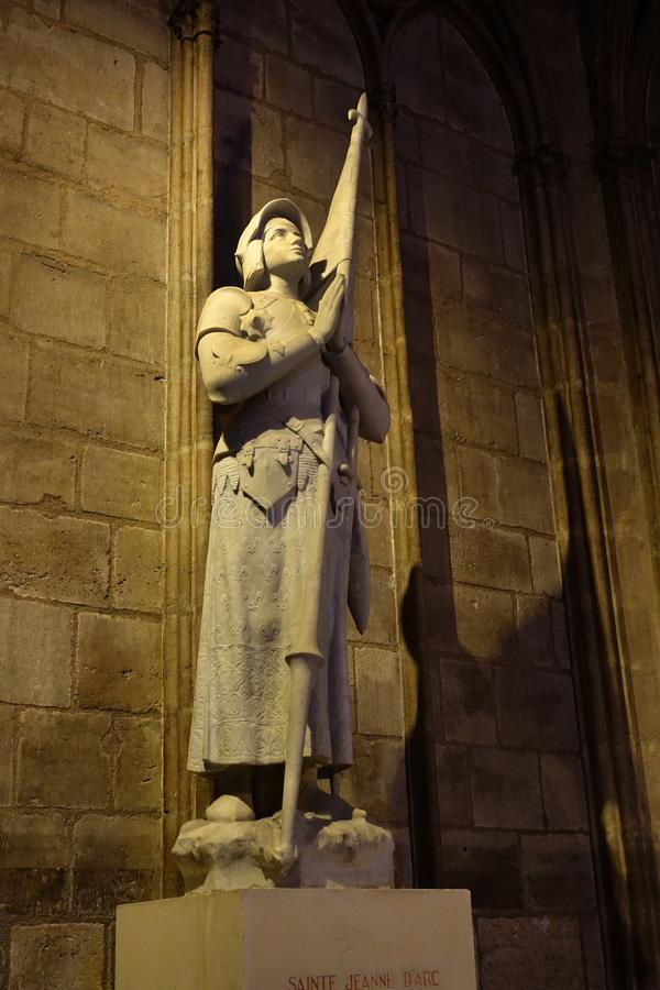 Joan of Arc Sculpture Interior Notre Dame, Paris, France. A marble statue of Joan of Arc located in the interior of Notre Dame Cathedral. Photographed 2017 prior stock photos