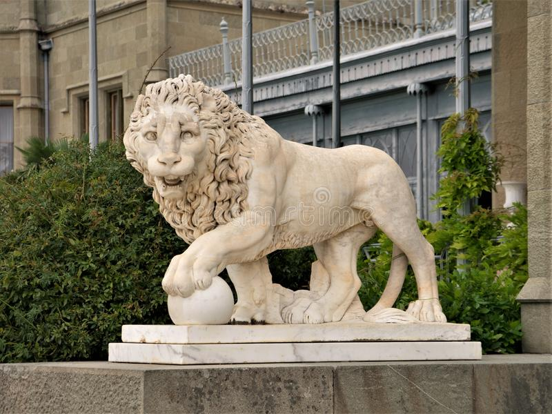 Marble statue of a lion with a ball. Crimea. Vorontsov Palace. Marble statue of a lion with a ball. Crimea. Vorontsov Palace stock image