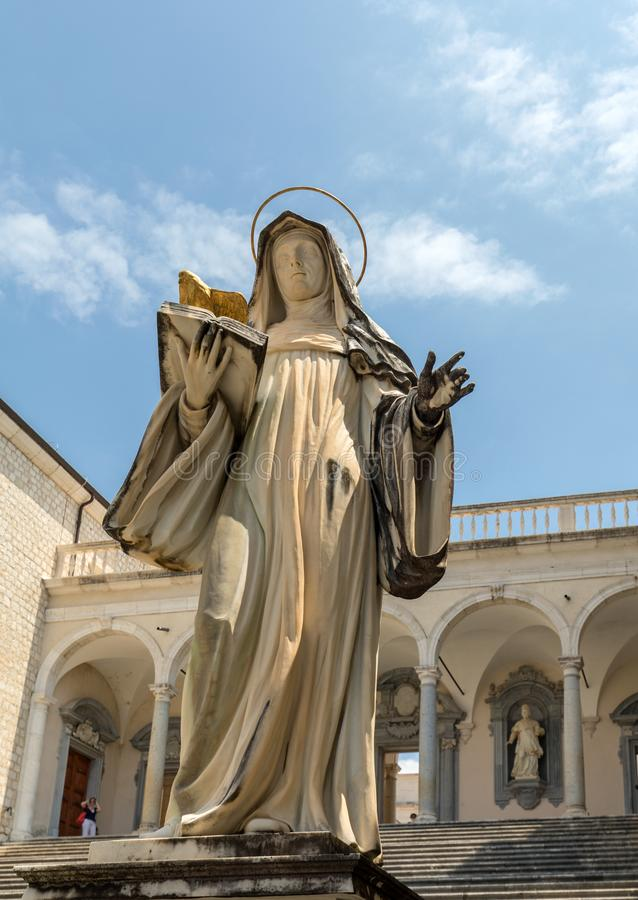 Marble statue of St. Scholastica by P. Campi of Carrara, in the Cloister of Bramante, Benedictine abbey of Montecassino. Italy stock photo