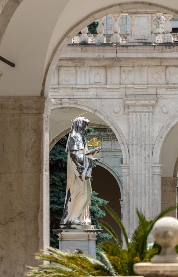 Marble statue of St. Scholastica by P. Campi of Carrara, in the Cloister of Bramante, Benedictine abbey of Montecassino. royalty free stock photos
