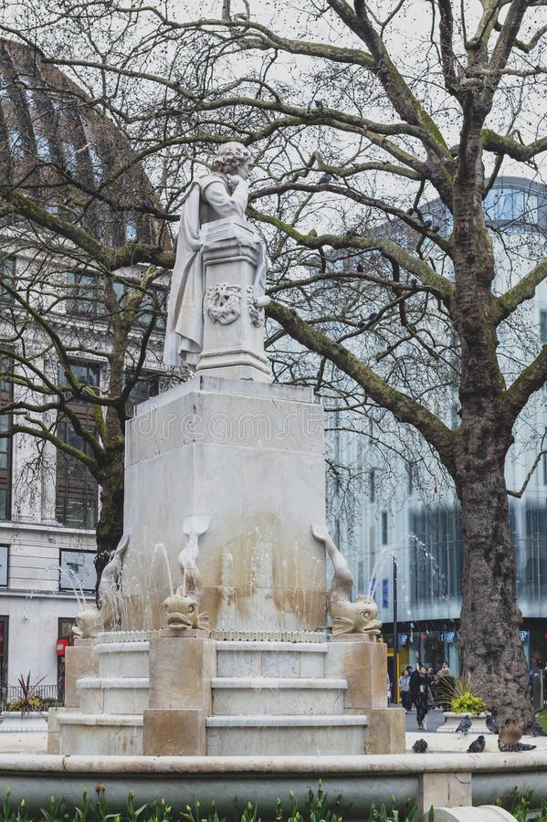 Marble statue of William Shakespeare at Leicester Square Garden in London, United Kingdom. London, UK - April 2018: The Shakespeare fountain and marble statue of royalty free stock photo