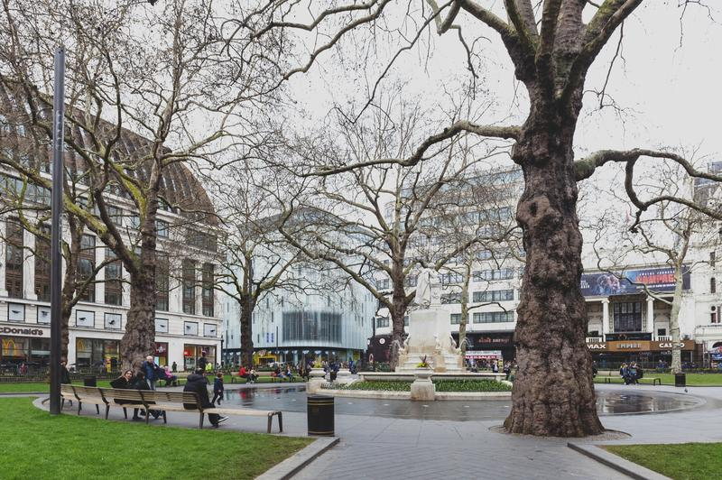 Marble statue of William Shakespeare at Leicester Square Garden in London, United Kingdom. London, UK - April 2018: The Shakespeare fountain and marble statue of stock photo