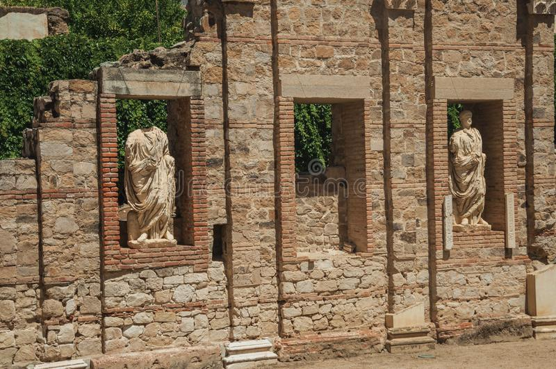 Marble statues in a brick wall of Roman Forum building in Merida. Close-up of marble statues in a brick wall reminiscent of Roman Forum building in Merida stock photos