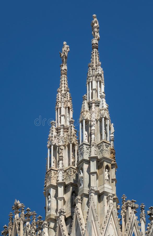 Marble statues on top of cathedral roof stock image