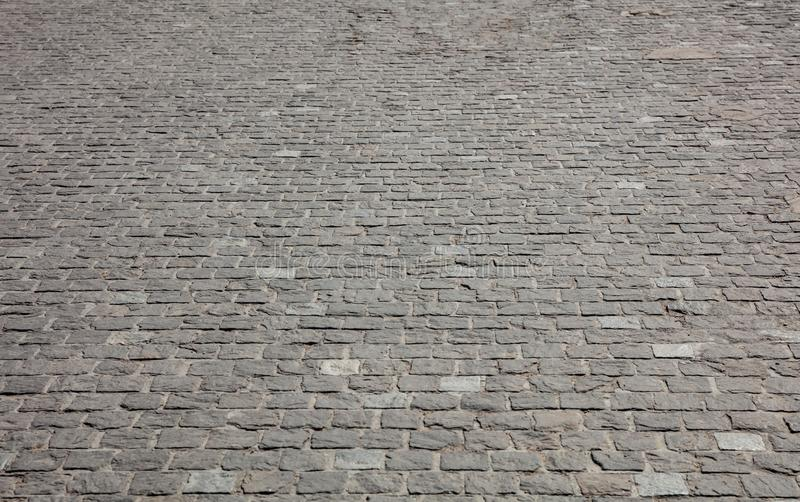 Marble stone paved street, texture background, view from above. Marble stone grey color paved street, texture background, view from above stock photos
