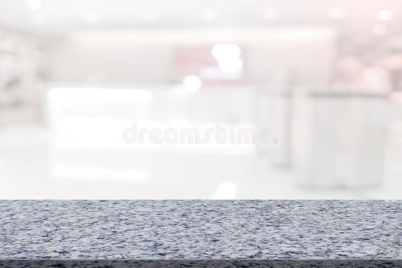 Marble table with register counter blurry background.  royalty free stock images