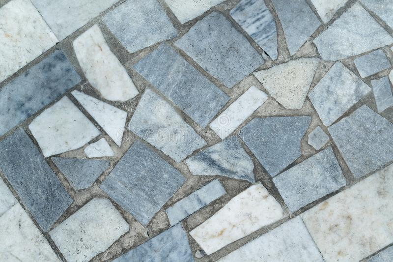 Marble tiles of different shapes laid out on a flat surface. royalty free stock photography