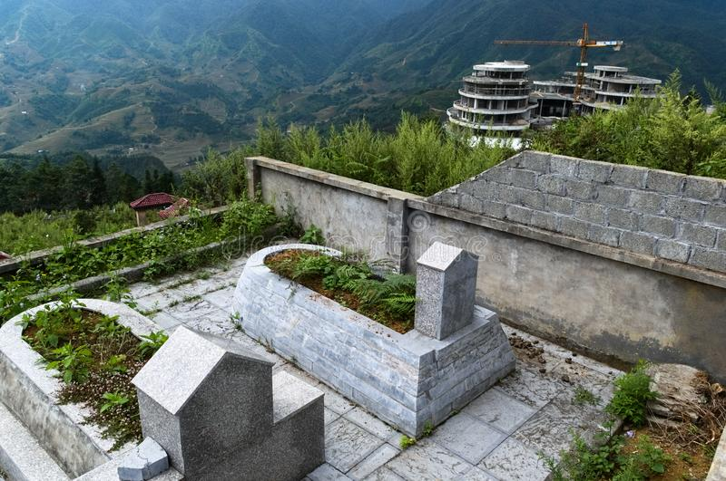 Marble tombstones on Vietnamese cemetery in mountains royalty free stock photography