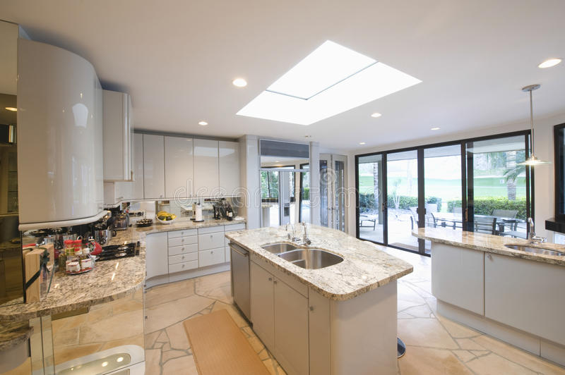 Marble Topped Worktop Units In Modern Kitchen. View of marble topped worktop units in modern kitchen at home royalty free stock photos