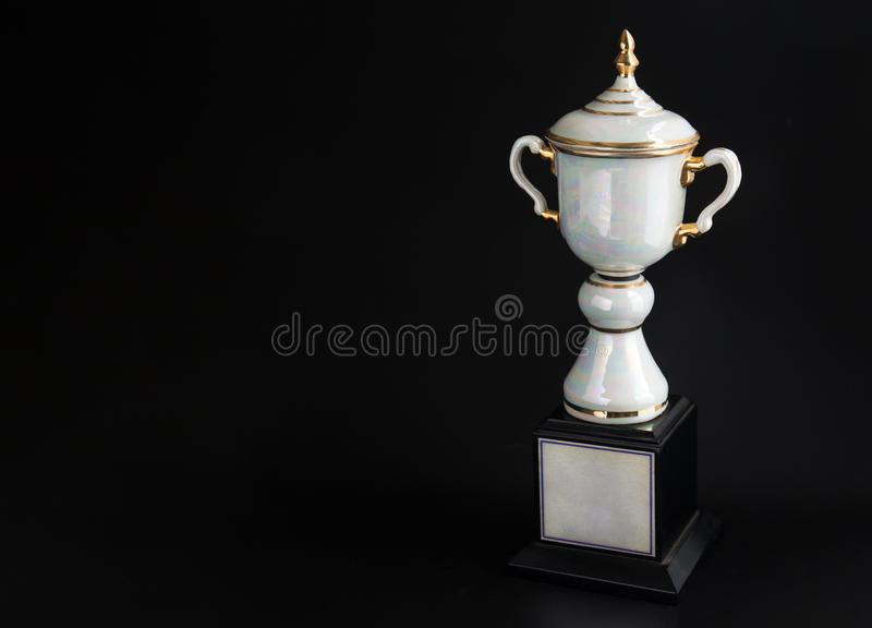 Marble trophy over black background. Winning awards with copy space for text and design. royalty free stock photos
