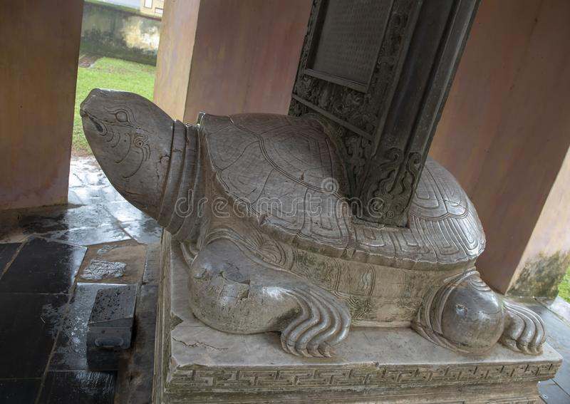 Marble Turtle sculpture with stele on back, Thien Mu Pagoda, Hue, Vietnam. Pictured a marble sculpture of a turtle with a stele on his back in a small pavilion stock photos