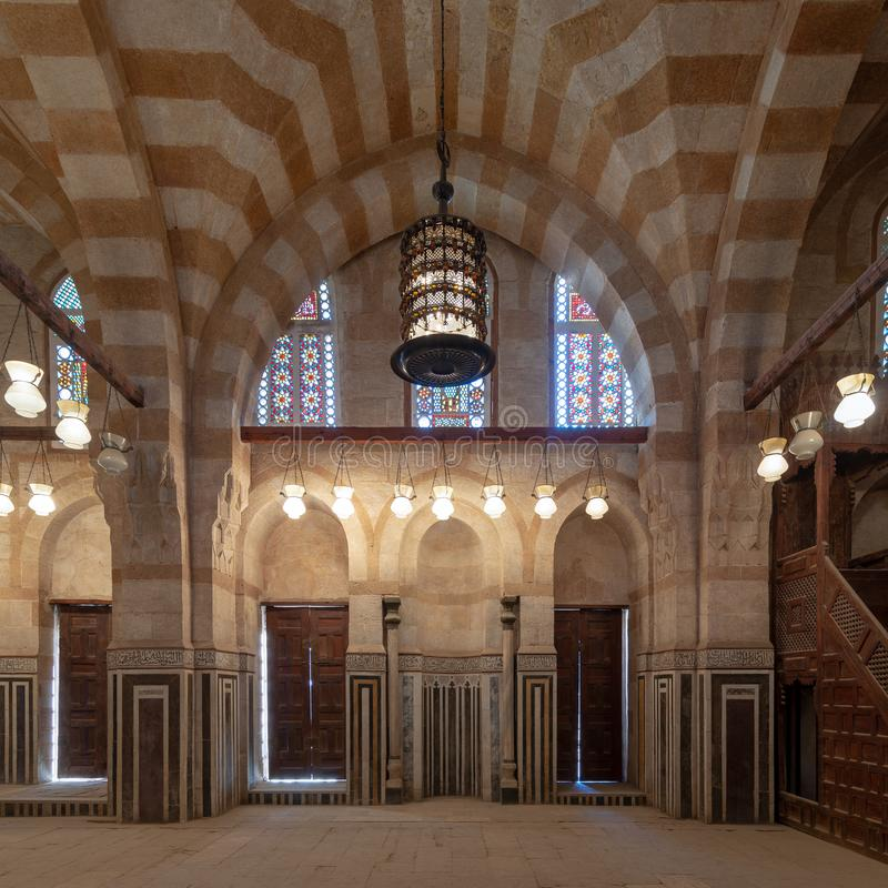 Marble wall with mihrab niche, wooden doors, huge arches and stained glass windows, Khayer Bek Mausoleum, Old Cairo, Egypt. Marble wall with mihrab Embedded stock photos