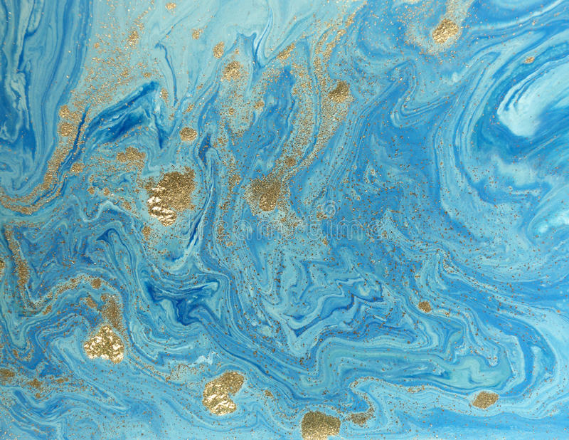 Marbled blue and golden abstract background. Liquid marble pattern royalty free stock photography