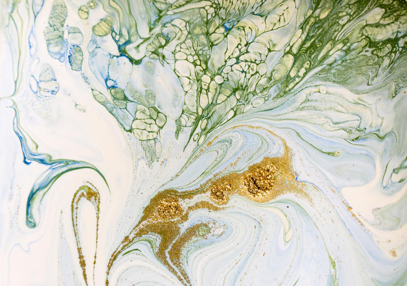 Marbled blue, green and gold abstract background. Liquid marble pattern. royalty free stock photography