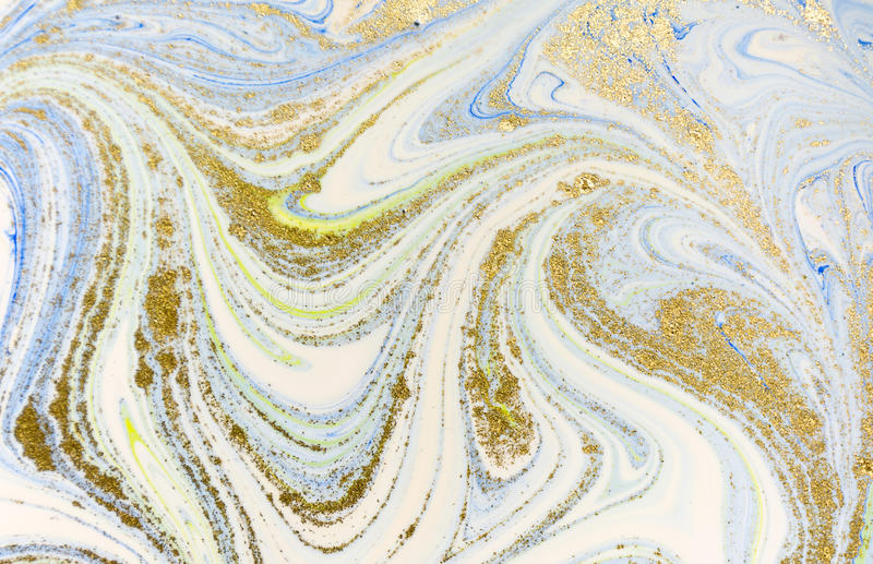 marbled blue white and gold abstract background liquid