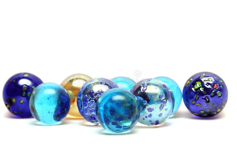Marbles. Glass beads on a white background royalty free stock photos