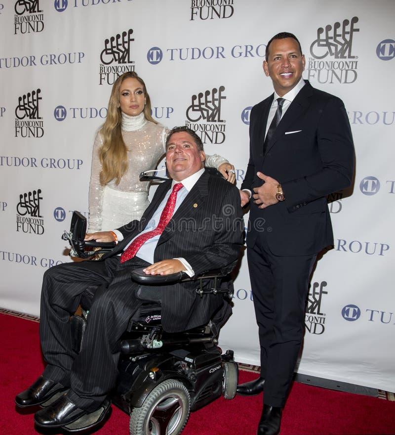 Marc Buoniconti, Alex Rodriguez, and Jennifer Lopez royalty free stock photo