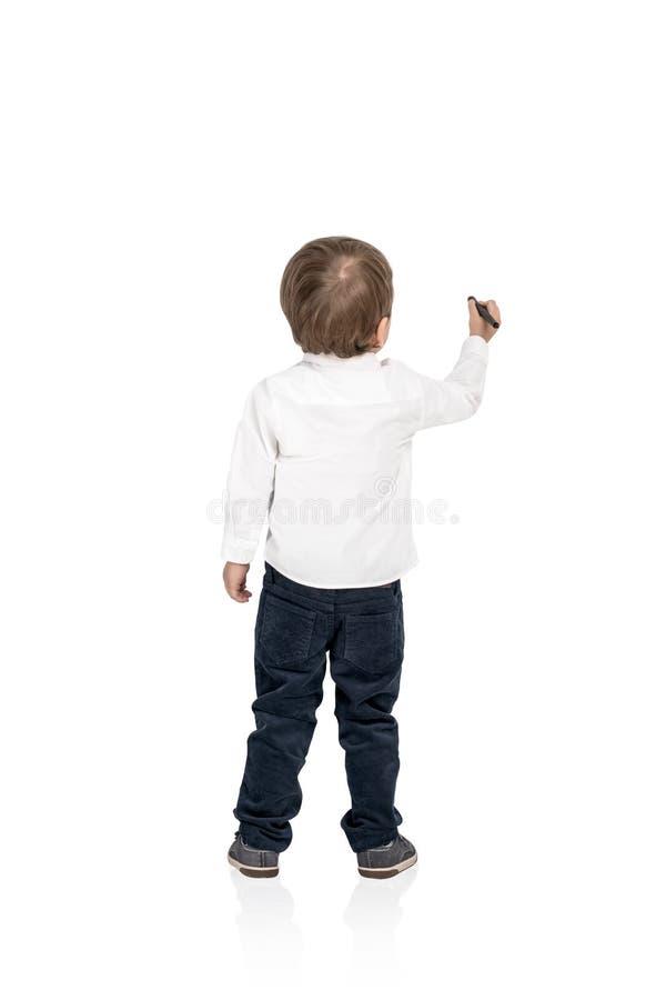 Marcador lindo del dibujo de la escritura del niño pequeño aislado imagen de archivo libre de regalías