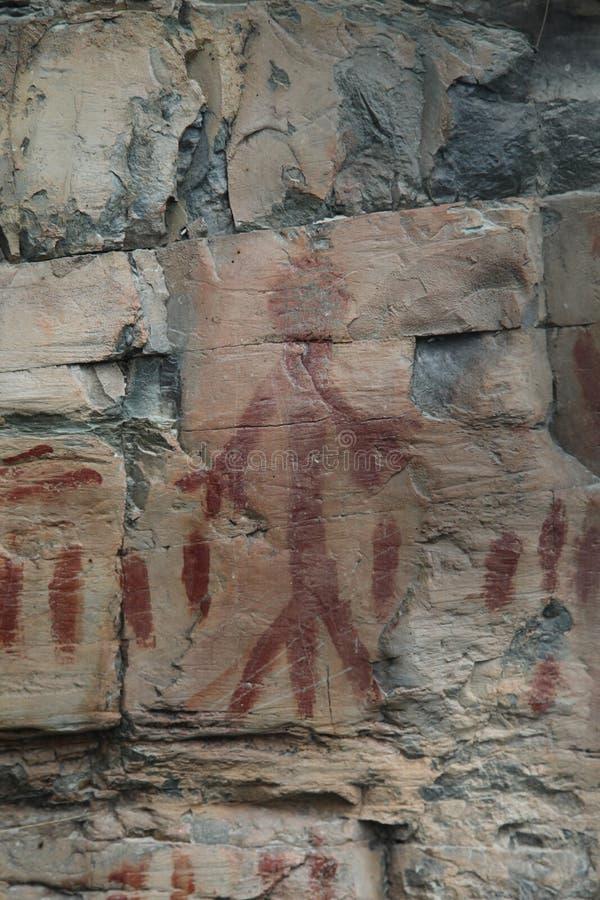 Marcas antigas do homem e do registro da arte da rocha do nativo americano fotografia de stock royalty free