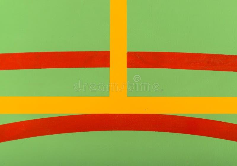 Marcas coloridas en una corte interior verde imagen de archivo libre de regalías