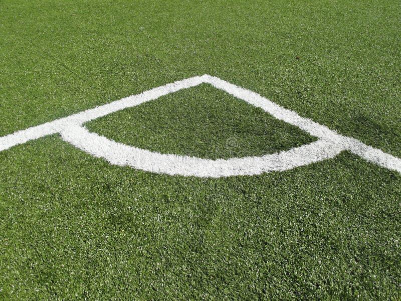 Marcatura d'angolo sul campo di calcio fotografia stock