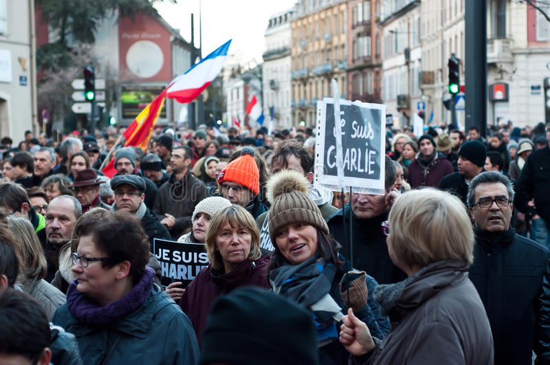 March against Charlie Hebdo magazine terrorism attack, on January 7th, 2015 in Paris. MULHOUSE - France - 11 January 2015 - March against Charlie Hebdo magazine royalty free stock image