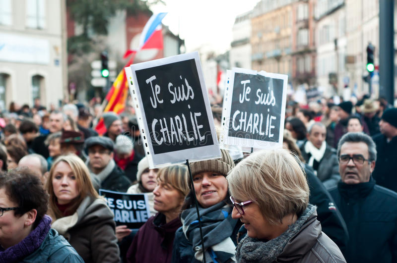 March against Charlie Hebdo magazine terrorism attack, on January 7th, 2015 in Paris. MULHOUSE - France - 11 January 2015 - March against Charlie Hebdo magazine royalty free stock images