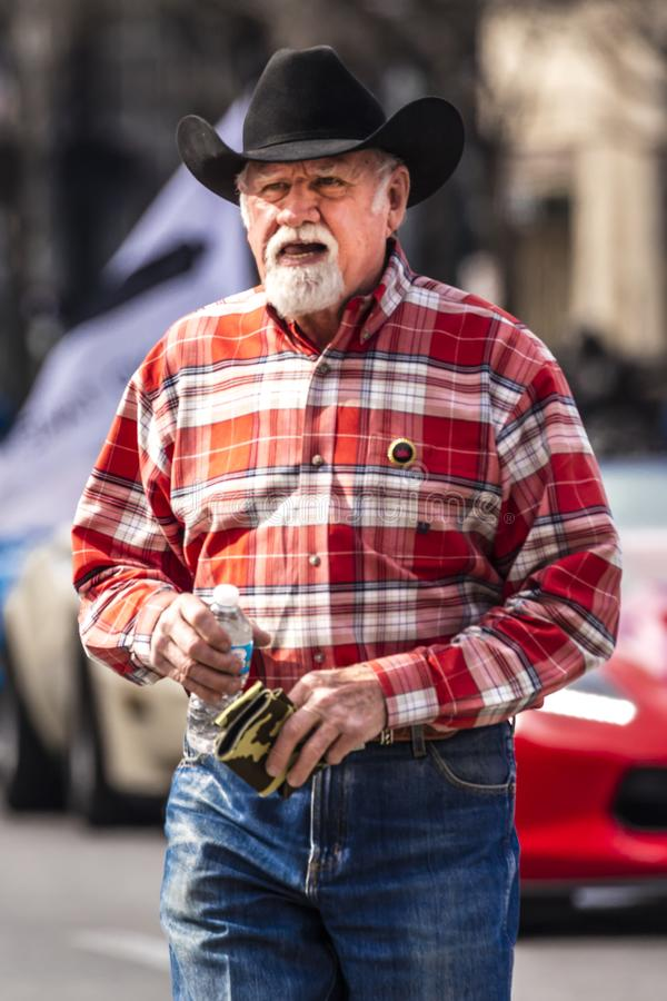 MARCH 3, 2018 - AUSTIN TEXAS - Local Cowboy celebrates Texas Independence Day Parade on Congress. March, Capitol. MARCH 3, 2018 - AUSTIN TEXAS - Local Cowboy stock photography