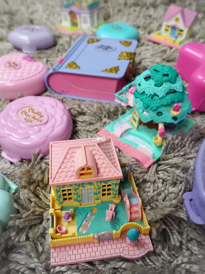 Collection of Polly Pocket`s, miniature dollhouses, that were very popular in the 90`s and now are coveted. March 2019 - Belgium Collection of Polly Pocket`s stock image
