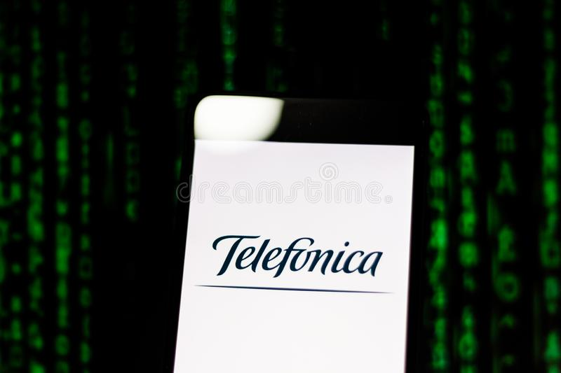 March 10, 2019, Brazil. `Telefonica` logo on the mobile device screen. Operating globally, it is one of the largest fixed and mob royalty free stock images