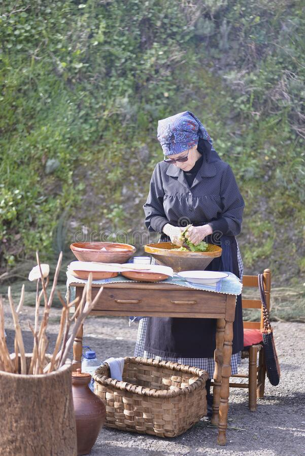 March 7, 2020 Caminomorisco in Caceres Spain. Woman cutting vegetables royalty free stock photo