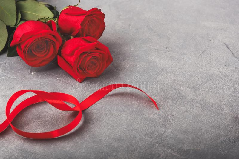 8 march happy womens day. Red roses and red ribbon on the table stock image