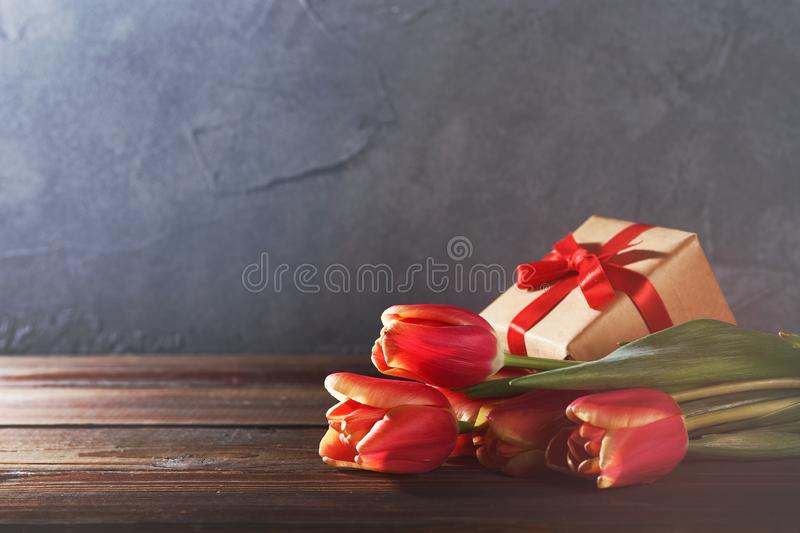 8 march happy womens day. Red tulips and gift box stock images