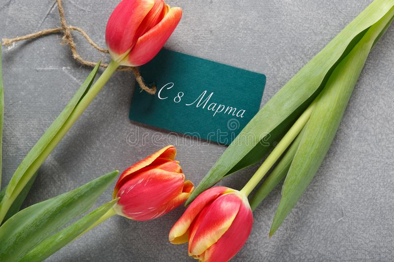 8 march happy womens day. White tulips, a cup of morning coffee and a gift box on the table stock photo