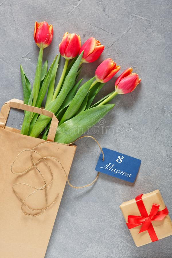8 march happy womens day. White tulips, a cup of morning coffee and a gift box on the table stock image