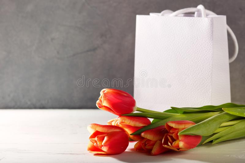 8 march happy womens day. Red tulips and gift box royalty free stock photos