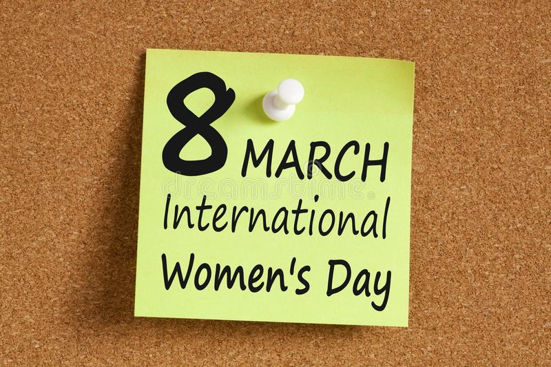 8 march International Women`s Day concept. 8 march International Women`s Day written on remember note pinned on a cork board.Business concept royalty free stock images
