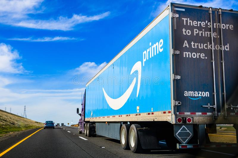 March 19, 2018 Kettleman City / CA / USA - Amazon truck driving on the interstate, the large Prime logo printed on the side stock photo