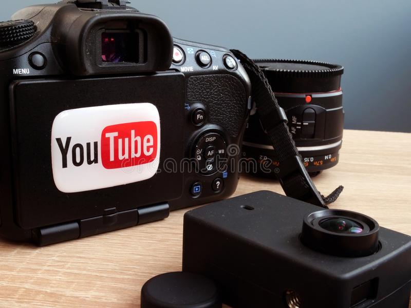 04 march 2018. Kyiv. Ukraine. YouTube logo on a camera. Video blogging or vlogs concept. royalty free stock photo