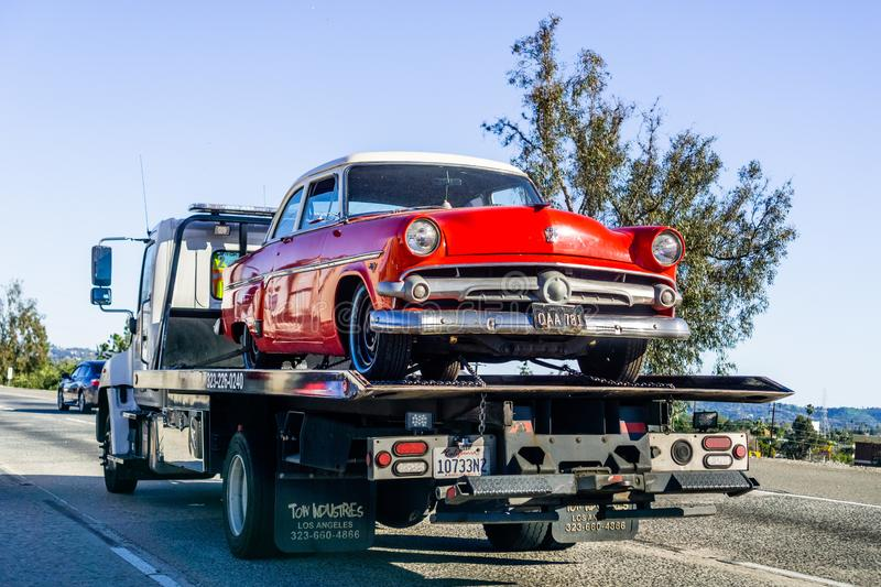 March 16, 2019 Los Angeles / CA / USA - Truck carrying a vintage Ford car on the highway stock photos