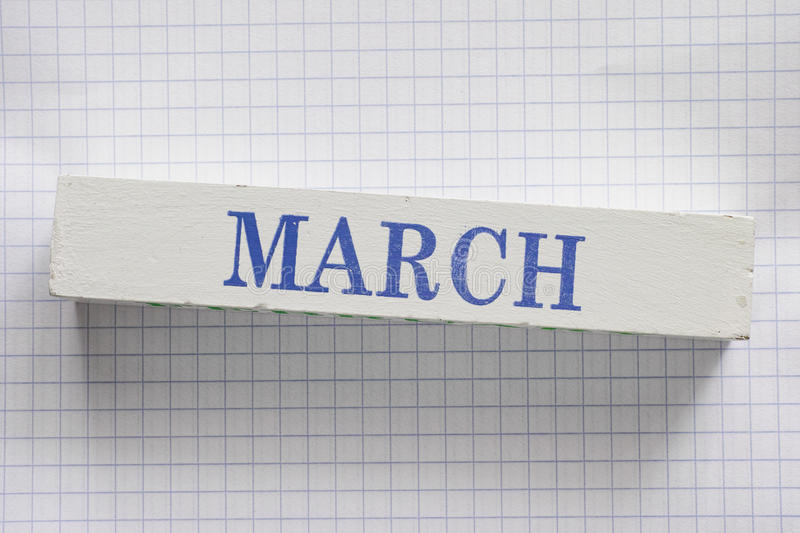 March. Month printed on wooden block royalty free stock photos