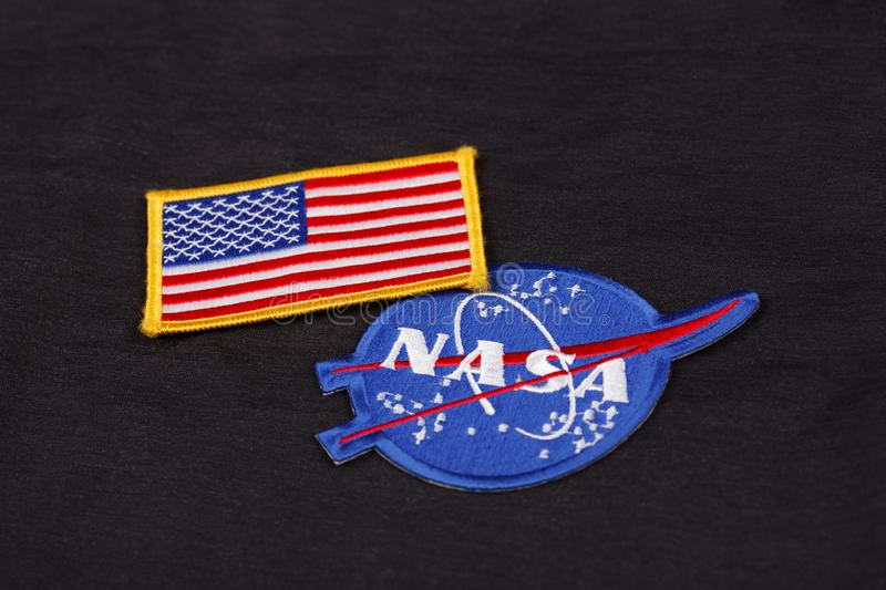 15 March 2018 - The National Aeronautics and Space Administration (NASA) emblem patch and US Flag patch on black uniform stock images