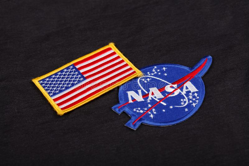 15 March 2018 - The National Aeronautics and Space Administration (NASA) emblem patch and US Flag patch on black uniform royalty free stock photos